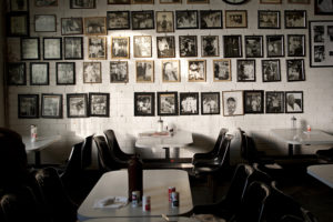 01_The-walls-of-the-café-within-Billingsgate-Market-is-hung-row-after-row-with-photographs-of-past-porters.jpg