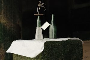 Two-Glass-Bottles-Pint-Glass-Round-Metal-Plate-some-Wire-and-a-White-Tile-copy.jpg